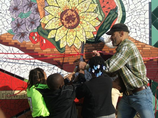 """To publicize these efforts to a broad audience, Toolkit project partners created the Southside Green Economy Tour. It introduced participants to a range of green initiatives in the area, such as the <a href=""""http://www.facebook.com/pages/Bronzeville-Community-Garden/116547401698902"""">Bronzeville Community Garden</a>, where a new mosaic by local artist <a href=""""http://studioelainemosaic.com/index.php?option=com_content&view=frontpage&Itemid=1"""">Carolyn Elaine</a> was recently installed..."""
