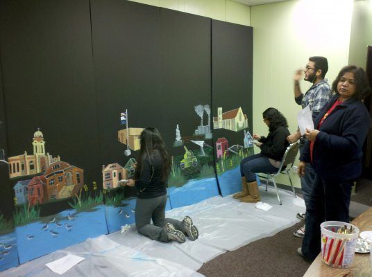 "The youth worked with an artist and a Web developer to turn the stories into a mural and a website that showcase residents ""going green."""