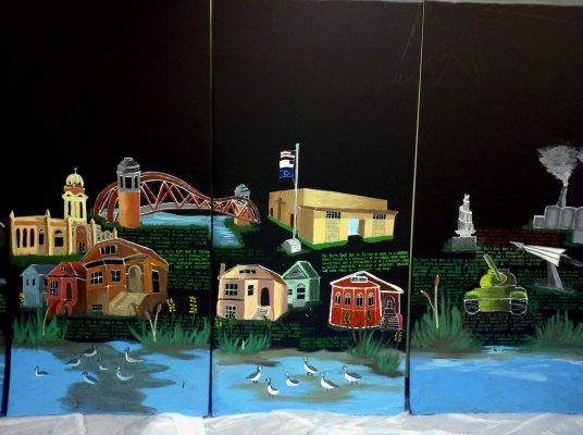 """The exhibit includes displays at 11 different locations. They highlight the variety of ways in which Southeast Side residents are already living """"green"""" and include information on contacting the SCRP to inquire about a home retrofit."""