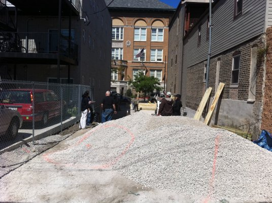 Ultimately, a layer of gravel and geotextile fabric was laid on top of the existing soil. This created a barrier between the contaminated soil and the new, clean soil added on top