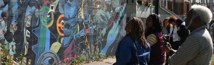 People looking at mural